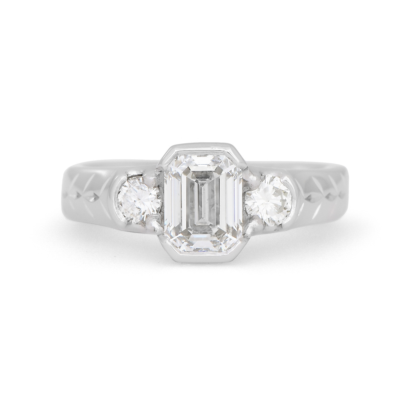 emerald cut engagement ring with engraving