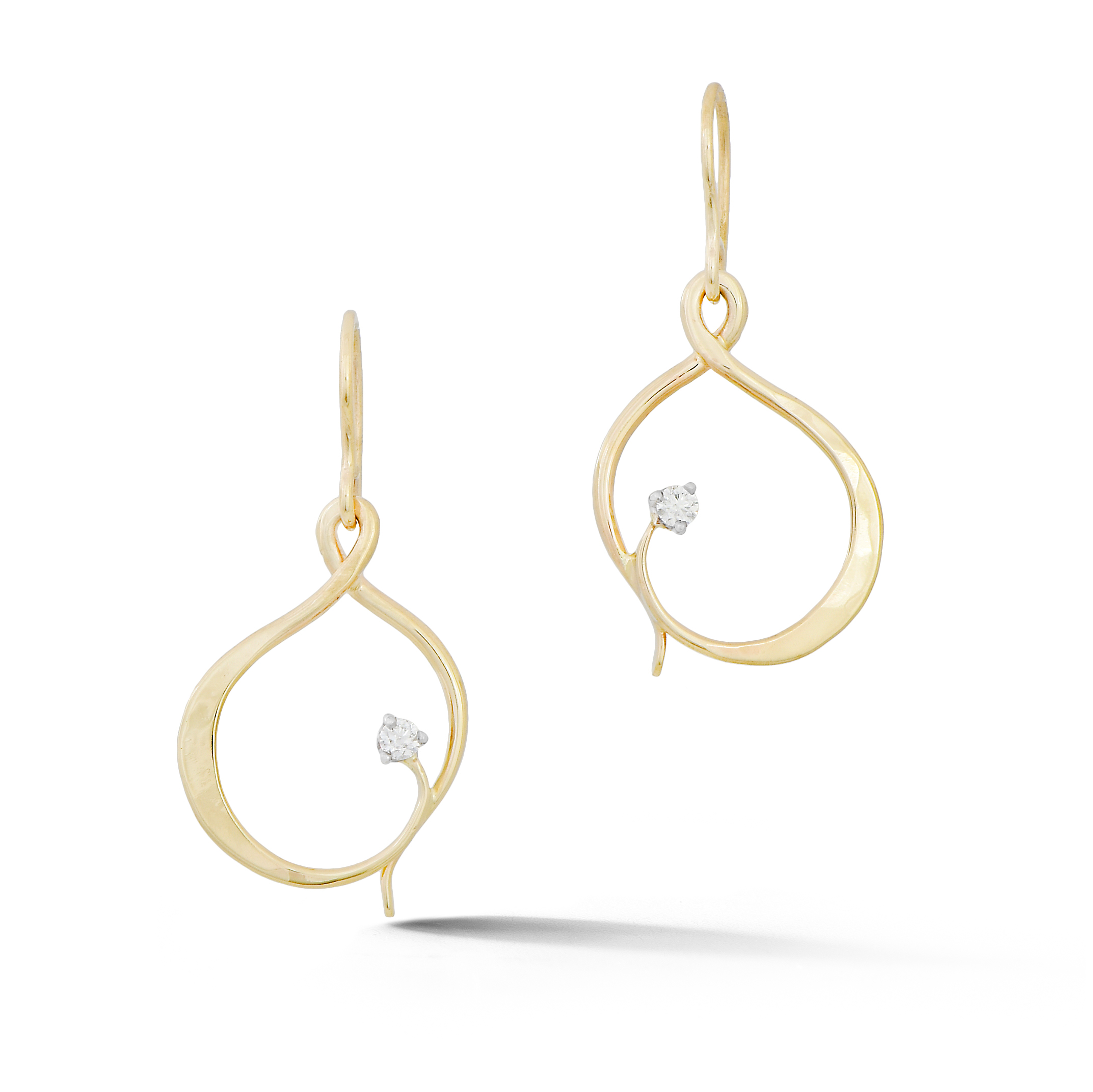 Hand forged gold earrings with diamonds