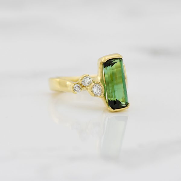 Green tourmaline and diamond 18ky ring